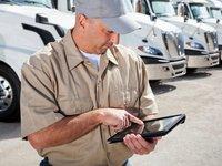 Truck driver using BOLT Tandem out of cab dispatch mobile unit